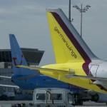 Klage gegen fünf Fluggesellschaften Vorauszahlungspraxis auf Justitias Prüfstand